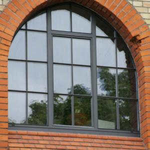 traditional steel window with arched head