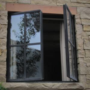 steel framed windows in stone opening