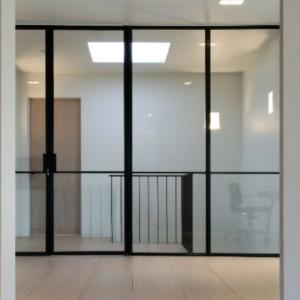 steel framed pivot door in screen